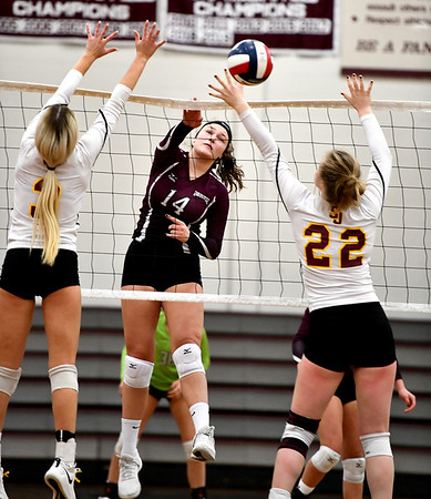 11/14/2019 Mike Orazzi | StaffrBristol Central High School's Kathryn Ross (14) at the net with St. Joseph's Jenna Koonitsky (3) and Lily Mattison (22) during the Class L Second Round Girls Volleyball Tournament at BCHS.