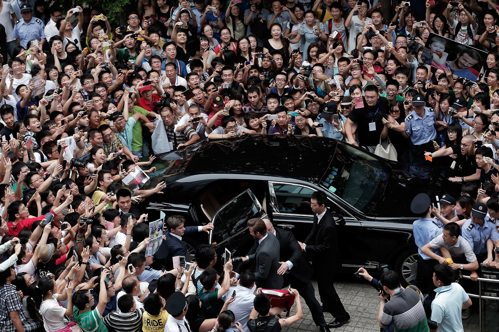 . David Beckham is surrounded by fans as he visits Tongji University on June 20, 2013 in Shanghai, China.  (Photo by Lintao Zhang/Getty Images)