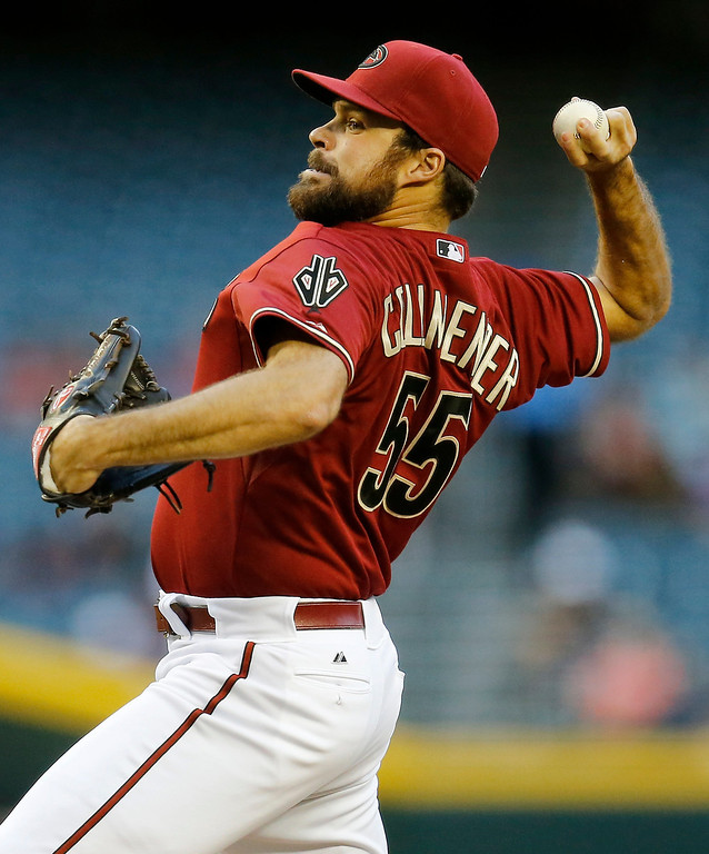 . Arizona Diamondbacks pitcher Josh Collmenter throws against the Colorado Rockies during the first inning of a baseball game on Wednesday, April 30, 2014, in Phoenix. (AP Photo/Matt York)