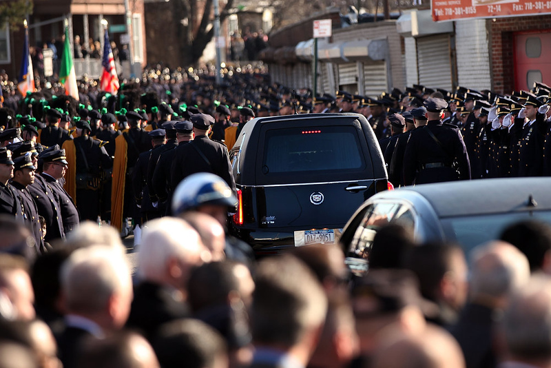 . The funeral procession is viewed leaving the Christ Tabernacle Church during the funeral of slain New York City Police Officer Rafael Ramos, one of two officers murdered while sitting in their patrol car in an ambush in Brooklyn last Saturday afternoon on December 27, 2014 in New York City. Thousands of fellow officers, family, friends and Vice President Joseph Biden are expected at the church in the Glendale neighborhood of Queens for the funeral.  (Photo by Spencer Platt/Getty Images)