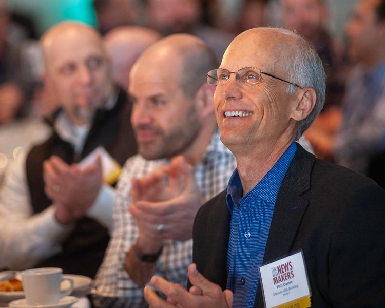 Phil Carter of Skanska USA Building applauds an award-winner. (Josh Kulla/DJC)