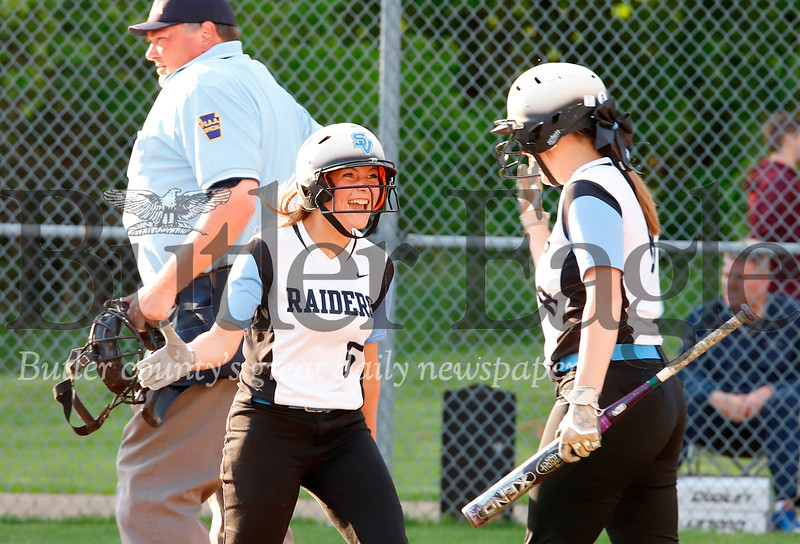 Olivia Madey (#8 Left) congratulates Mackenzie Baker after scoring a run. Seb Foltz/Butler Eagle