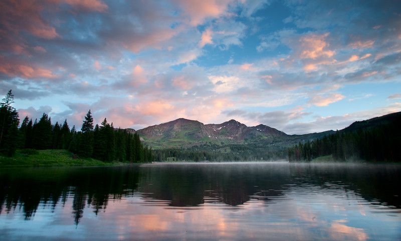 Colorful sunrise reflected in Lake Irwin near Crested Butte, Colorado.