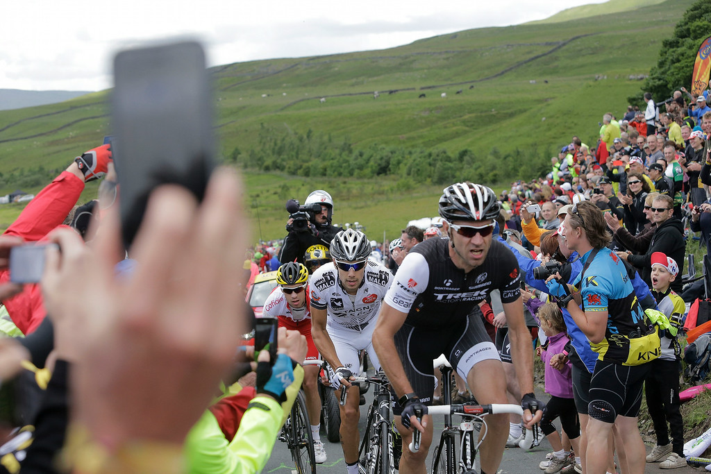 . Germany\'s Jens Voigt, front, France\'s Benoit Jarrier, center, and France\'s Nicolas Edet, rear, climb Cray pass in the breakaway group during the first stage of the Tour de France cycling race over 190.5 kilometers (118.4 miles) with start in Leeds and finish in Harrogate, England, Saturday, July 5, 2014. (AP Photo/Laurent Cipriani)