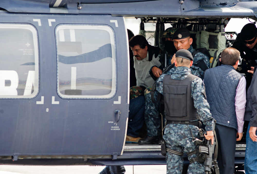 """. Joaquin \""""El Chapo\"""" Guzman sits inside a federal police helicopter at a navy hanger in Mexico City, Saturday, Feb. 22, 2014. A senior U.S. law enforcement official said Saturday, that Guzman, the head of Mexicoís Sinaloa Cartel, was captured alive overnight in the beach resort town of Mazatlan. Guzman faces multiple federal drug trafficking indictments in the U.S. and is on the Drug Enforcement Administrationís most-wanted list. (AP Photo/Eduardo Verdugo)"""