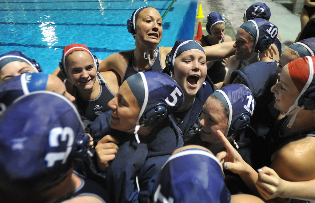 . Crescenta Valley players celebrate their win over Redlands East Valley in the Southern Section Div. V semifinals girls water polo game at Whittier College\'s Lillian Slade Aquatics Center on Wednesday February 20, 2013. Crescenta Valley beat Redlands East Valley 14-4. (Staff photo by Keith Durflinger)