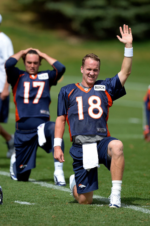 . Denver Broncos quarterback Peyton Manning (18) stretches during practice August 23, 2013 at Dove Valley (Photo by John Leyba/The Denver Post)