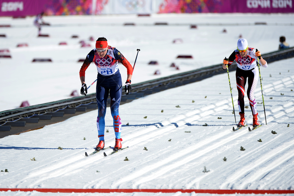 . Olga Kuziukova of Russia approaches the finish line ahead of Katerina Smutna of Austria as they compete in the Women\'s 10 km Classic during day six of the Sochi 2014 Winter Olympics at Laura Cross-country Ski & Biathlon Center on February 13, 2014 in Sochi, Russia.  (Photo by Harry How/Getty Images)