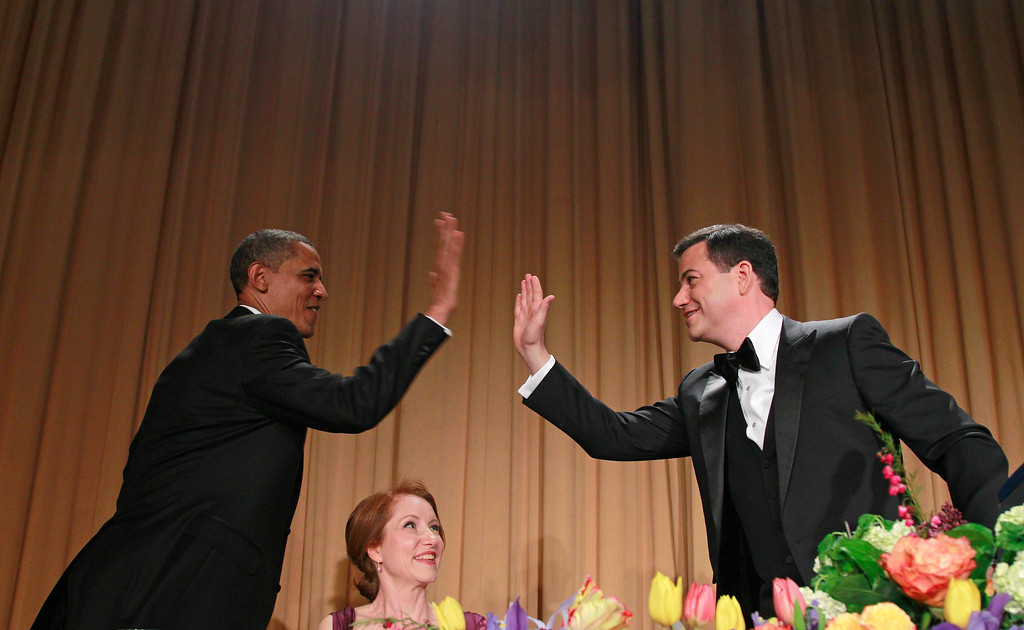 . President Barack Obama high-fives late-night comic Jimmy Kimmel as Caren Bohan, a Reuters journalist and president of the White House Correspondents\' Association watches during the White House Correspondents\' Association Dinner, Saturday, April 28, 2012 in Washington. (AP Photo/Haraz N. Ghanbari)