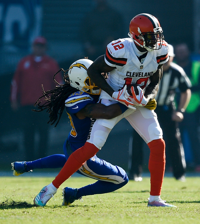 . Cleveland Browns wide receiver Josh Gordon, right, is tackled by Los Angeles Chargers free safety Tre Boston during the first half of an NFL football game Sunday, Dec. 3, 2017, in Carson, Calif. (AP Photo/Kelvin Kuo)