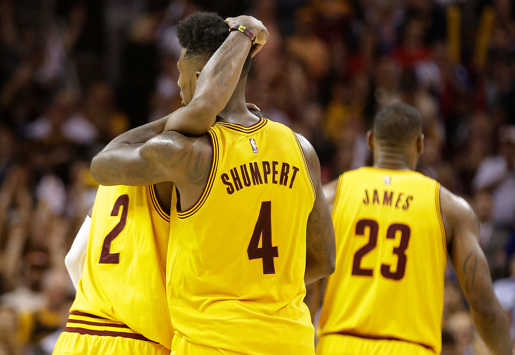 . Cleveland Cavaliers guard Iman Shumpert (4) hugs Cleveland Cavaliers guard Kyrie Irving (2) late in the second half against the Chicago Bulls during Game 5 in a second-round NBA basketball playoff series Tuesday, May 12, 2015, in Cleveland. The Cavaliers won 106-101. (AP Photo/Tony Dejak)