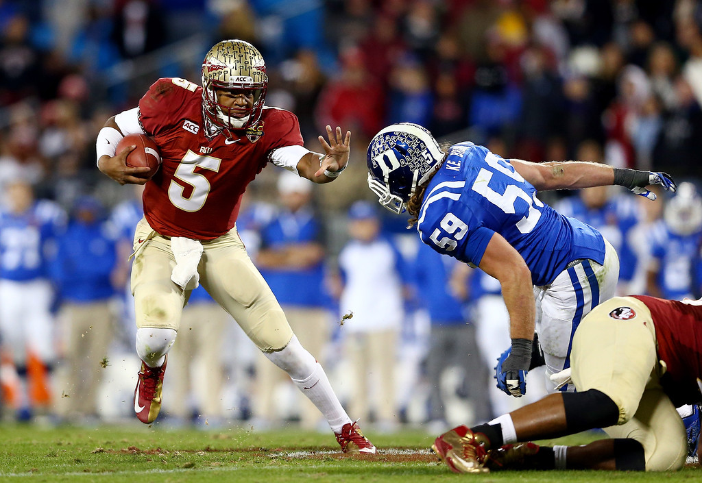 . Quarterback Jameis Winston #5 of the Florida State Seminoles is pressured by linebacker Kelby Brown #59 of the Duke Blue Devils during the ACC Championship game at Bank of America Stadium on December 7, 2013 in Charlotte, North Carolina.  (Photo by Streeter Lecka/Getty Images)