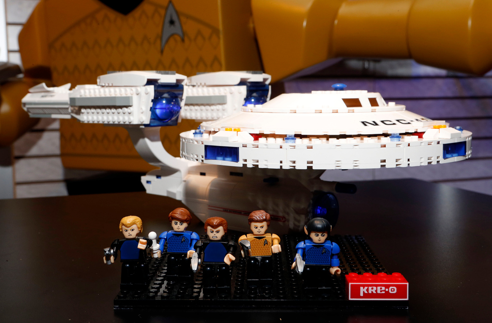. The ìKRE-O Star Trek Enterpriseî set, which lets kids build the iconic ship from the anticipated film ìStar Trek Into Darkness,î is featured on display with several KREON character figures in Hasbroís showroom at the American International Toy Fair, Saturday, Feb. 9, 2013, in New York. (Photo by Jason DeCrow/Invision for Hasbro/AP Images)