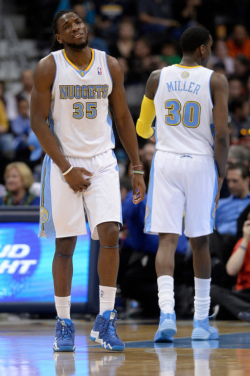 . Denver Nuggets forward Kenneth Faried (35) holds himself after drawing contact from Memphis Grizzlies center Marc Gasol (33) during the third quarter of action. (Photo by AAron Ontiveroz/The Denver Post)