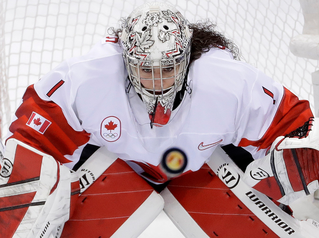 . goalie Shannon Szabados (1), of Canada, stares at the flying puck during the second period of the women\'s gold medal hockey game against the United States at the 2018 Winter Olympics in Gangneung, South Korea, Thursday, Feb. 22, 2018. (AP Photo/Matt Slocum)