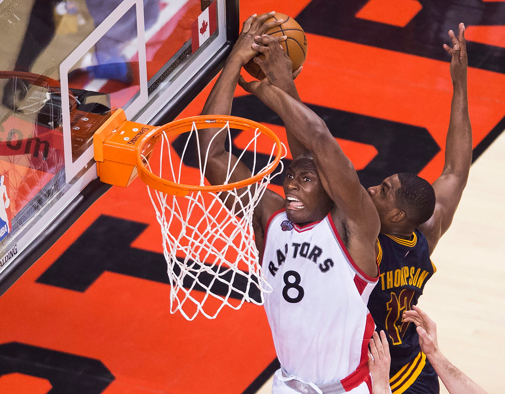 . Toronto Raptors center Bismack Biyombo (8) is rejected by Cleveland Cavaliers centre Tristan Thompson (13) during the first half of Game 3 of the NBA basketball Eastern Conference finals in Toronto on Saturday, May 21, 2016. (Nathan Denette/The Canadian Press via AP)
