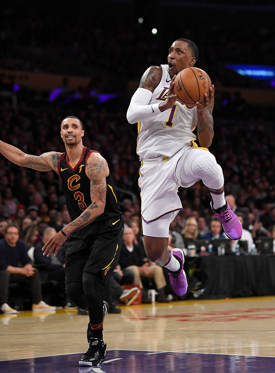 . Los Angeles Lakers guard Kentavious Caldwell-Pope, right, shoots as Cleveland Cavaliers guard George Hill defends during the second half of an NBA basketball game, Sunday, March 11, 2018, in Los Angeles. The Lakers won 127-113. (AP Photo/Mark J. Terrill)