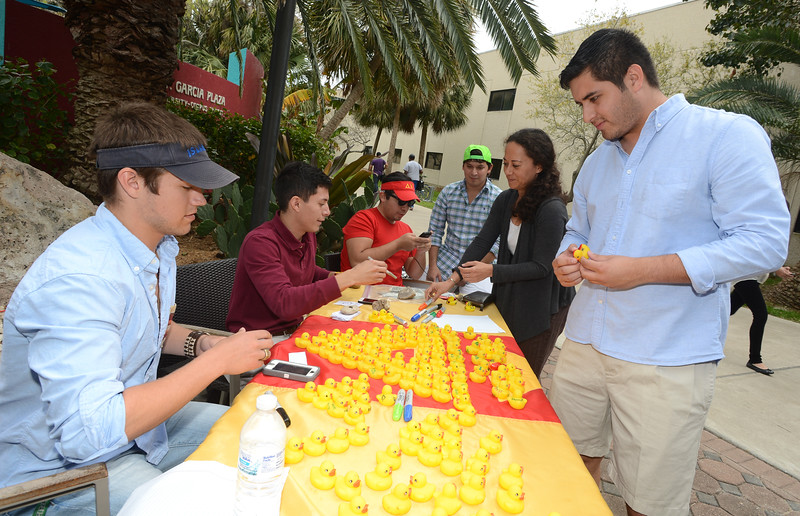 members-of-delta-chi-sell-rubber-ducks-for-their-annual-rubber-duck-race-benefitting-the-jimmy-v-foundation_13583678764_o.jpg