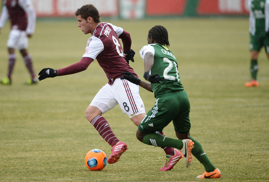 . COMMERCE CITY MARCH 22: Dillon Powers of Colorado Rapids (8), left, controls the ball against Diego Chara of Portland Timbers (21) in the 1st half of the game at Dick\'s Sporting Goods Park. Commerce City, Colorado. March 22. 2014. Colorado won 2-0. (Photo by Hyoung Chang/The Denver Post)