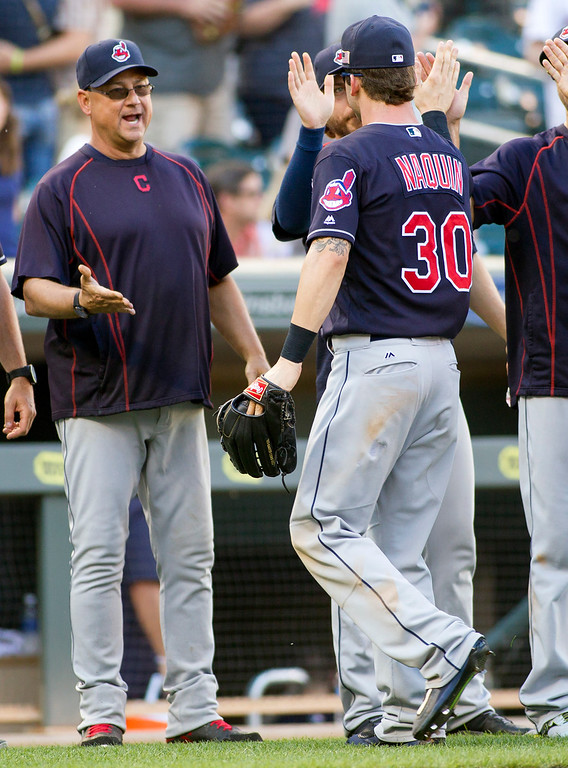 . Cleveland Indians manager Terry Francona, left, congratulates center fielder Tyler Naquin (30) after they defeated the Minnesota Twins in a baseball game, Sunday, Sept. 11, 2016, in Minneapolis. (AP Photo/Paul Battaglia)