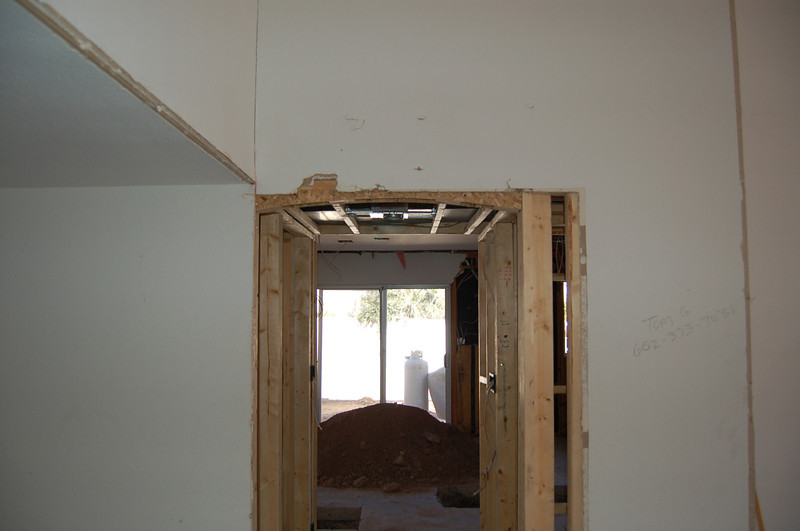 Hallway toward the kitchen, showing the side yard. Front door is to the left.