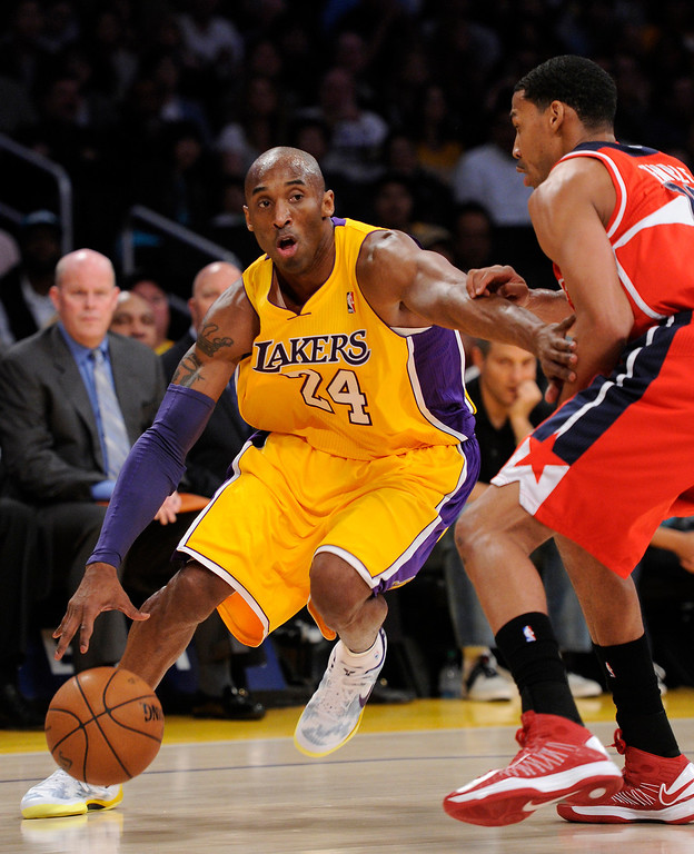 . The Lakers\' Kobe Bryant tries to drive around the Wizards\' Garrett Temple in the first half, Friday, March 22, 2013, at Staples Center. (Michael Owen Baker/Los Angeles Daily News)