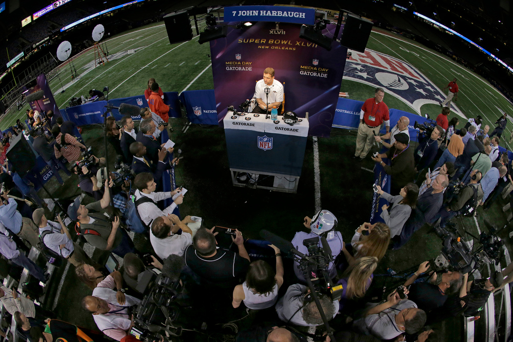 Description of . Baltimore Ravens head coach John Harbaugh  answers reporters questions during media day for the NFL Super Bowl XLVII football game Tuesday, Jan. 29, 2013, in New Orleans. (AP Photo/Gerald Herbert)
