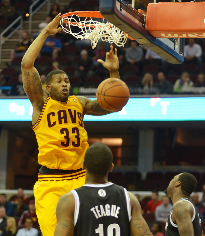 . Michael Allen Blair/Digital First Media Cavs\' guard Alonzo Gee dunks over Nets\' guard Marquis Teague during the fourth quarter of a game April 16 at Quicken Loans Arena.