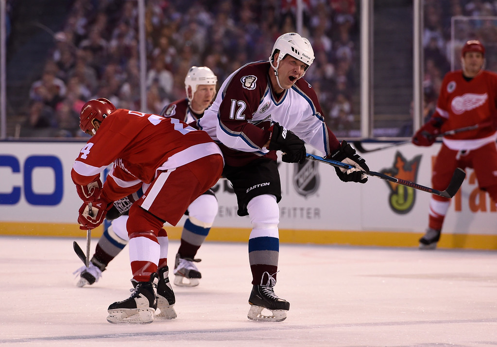 . DENVER, CO - FEBRUARY 26: Colorado Avalanche Chris Simon (12) gets a hip check by Detroit Red Wings Chris Chelios (24) during the first period February 26, 2016 at Coors Field. (Photo By John Leyba/The Denver Post)