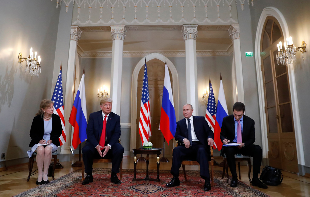 . U.S. President Donald Trump, second from left, listens to a statement of Russian President Vladimir Putin, second from right, at the beginning of a meeting at the Presidential Palace in Helsinki, Finland, Monday, July 16, 2018. (AP Photo/Pablo Martinez Monsivais)