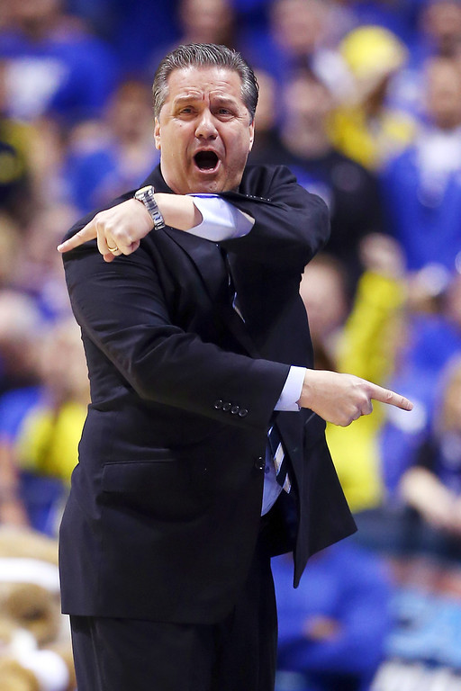 . Head coach John Calipari of the Kentucky Wildcats shouts to his players against the Michigan Wolverines during the midwest regional final of the 2014 NCAA Men\'s Basketball Tournament at Lucas Oil Stadium on March 30, 2014 in Indianapolis, Indiana.  (Photo by Andy Lyons/Getty Images)