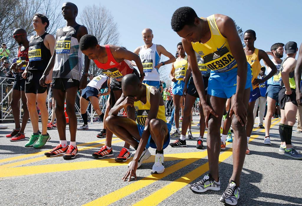 . Elite runners from foreground right, Lelisa Desisa, of Ethiopia, Wesley Korir, of Kenya, Yemane Tsegay, of Ethiopia, and Wilson Chebet, of Kenya, prepare for the start of the Boston Marathon in Hopkinton, Mass., Monday, April 18, 2016. (AP Photo/Michael Dwyer)