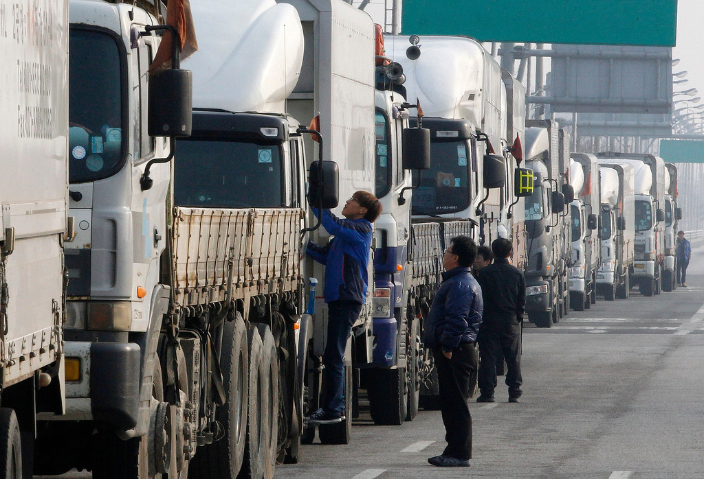 . South Korean truck drivers wait to head for the North Korea\'s city of Kaesong, at the customs, immigration and quarantine office in Paju, South Korea, near the border village of Panmunjom, Thursday, April 4, 2013. North Korea on Wednesday barred South Korean workers from entering a jointly run factory park just over the heavily armed border in the North, officials in Seoul said, a day after Pyongyang announced it would restart its long-shuttered plutonium reactor and increase production of nuclear weapons material. (AP Photo/Ahn Young-joon)
