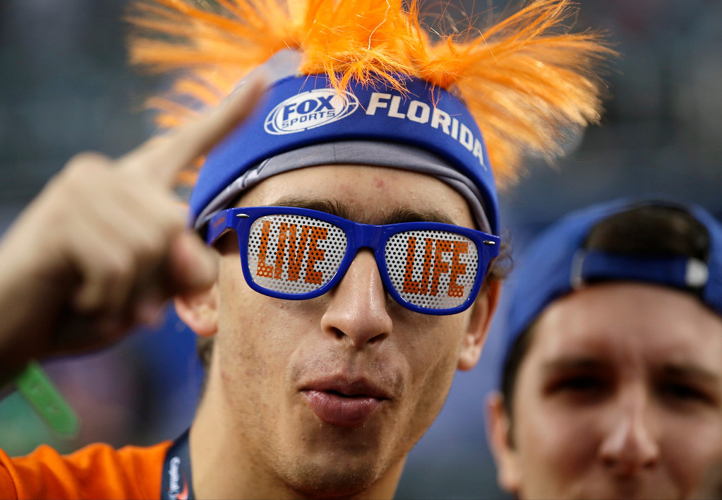 . A Florida fan reacts before an NCAA Final Four tournament college basketball semifinal game against Connecticut, Saturday, April 5, 2014, in Arlington, Texas. (AP Photo/David J. Phillip)