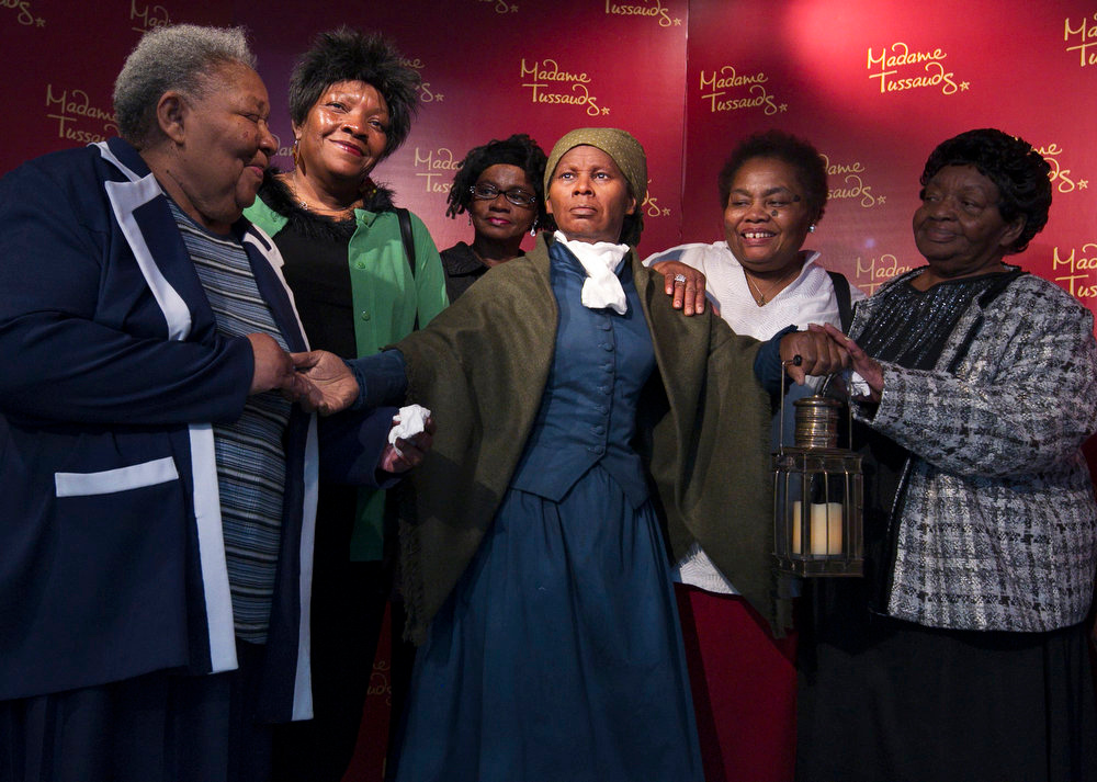 Description of . Harriet Ross Tubman's great great nieces and oldest living descendants, from left, Valery Ross Manokey, 76, of Cambridge, Md.; Peggy Ross, 60, of Cambridge, Md.; Delphine Slaughter, 62, of Hurlock, Md., adopted; Barbara Ross Stanley, 70, of Columbus, Ohio; and Bernice Ross Carney, 74, of Denton, Md.; gather around with a wax likeness of the renowned abolitionist and conductor of the Underground Railroad, at the Presidents Gallery by Madame Tussauds in Washington during the unveiling of the wax figure in celebration of Black History Month, Tuesday, February 7, 2012.  (AP Photo/Manuel Balce Ceneta)