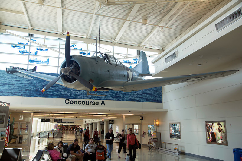 Midway Airport: A WW-II Douglas Dauntless Dive Bomber and a Battle of Midway memorial in the hallway.