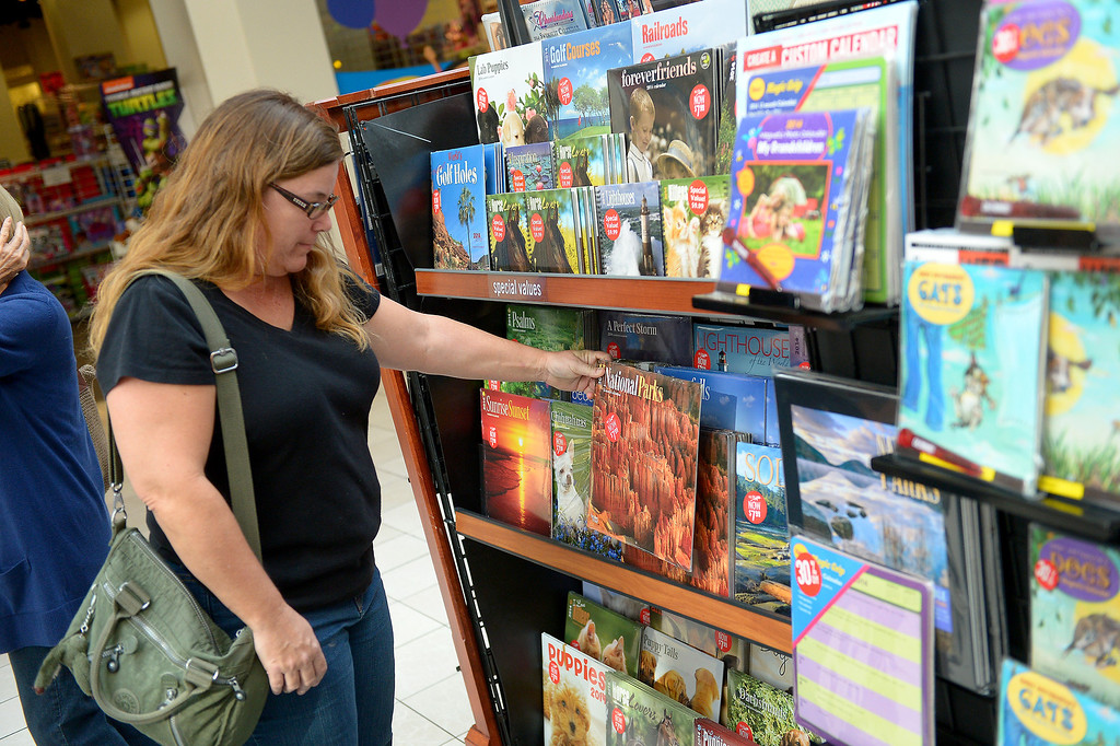 . Diana Dowthwaite, of Simi Valley, looks for calendars on sale at the Westfield Topanga, Thursday, December 26, 2013. (Photo by Michael Owen Baker/L.A. Daily News)