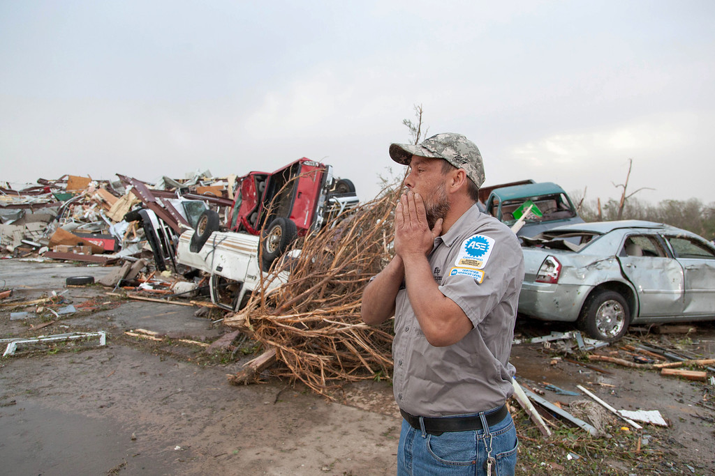 . John Smith reacts after seeing what\'s left of his auto repair shop in Mayflower, Ark., Monday, April 28, 2014, after a tornado struck the town late Sunday. Mayflower was hit hard Sunday after a tornado system ripped through several states in the central U.S. and left more than a dozen dead in a violent start to this year\'s storm season, officials said.  (AP Photo/Karen E. Segrave)