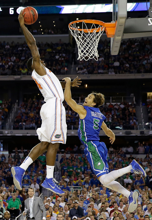 . Florida\'s Casey Prather (24) shoots over, Florida Gulf Coast\'s Christophe Varidel (5) during the first half of a regional semifinal game in the NCAA college basketball tournament, Friday, March 29, 2013, in Arlington, Texas. (AP Photo/David J. Phillip)