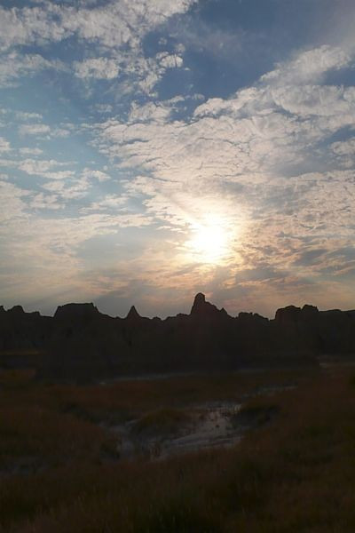 Sunset over the Badlands hints at the complex landscape.
