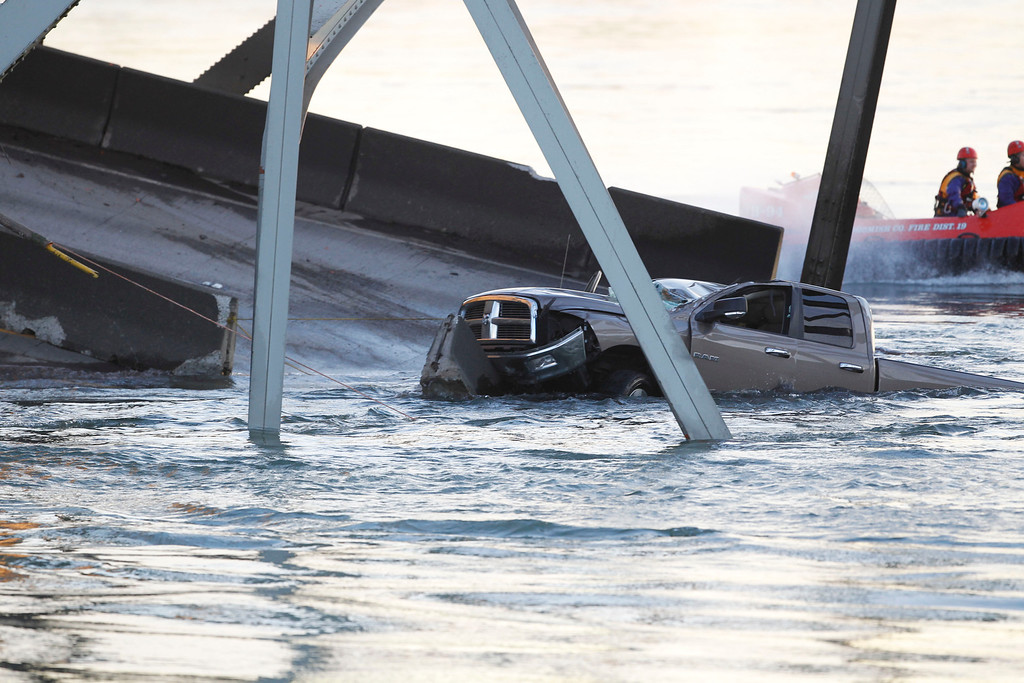 . A damaged truck sits in the water on a portion of the Interstate-5 bridge that is submerged after it collapsed into the Skagit river dumping vehicles and people into the water in Mount Vernon, Wash., Thursday, May 23, 2013 according to the Washington State Patrol. (AP Photo/Joe Nicholson)