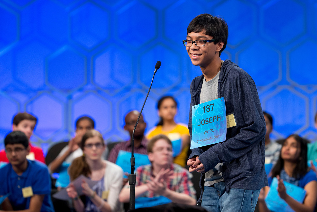 ". Eighth grade  student Joseph Cusi Delamerced, 14, of Cincinnati, Ohio, smiles after correctly spelling, ""salicetum\"", during the semifinals of the Scripps National Spelling Bee, Thursday, May 29, 2014, at National Harbor in Oxon Hill, Md.  (AP Photo/Manuel Balce Ceneta)"