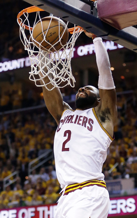 . Cleveland Cavaliers\' Kyrie Irving dunks against the Toronto Raptors during the second half of Game 1 of the NBA basketball Eastern Conference finals, Tuesday, May 17, 2016, in Cleveland. (AP Photo/Tony Dejak)