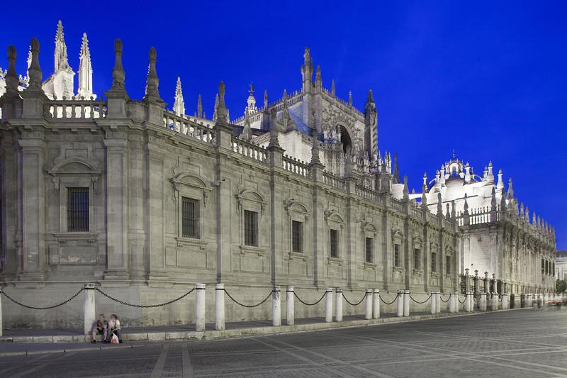 South side of Santa Maria de la Sede Cathedral at dusk, Seville, Spain