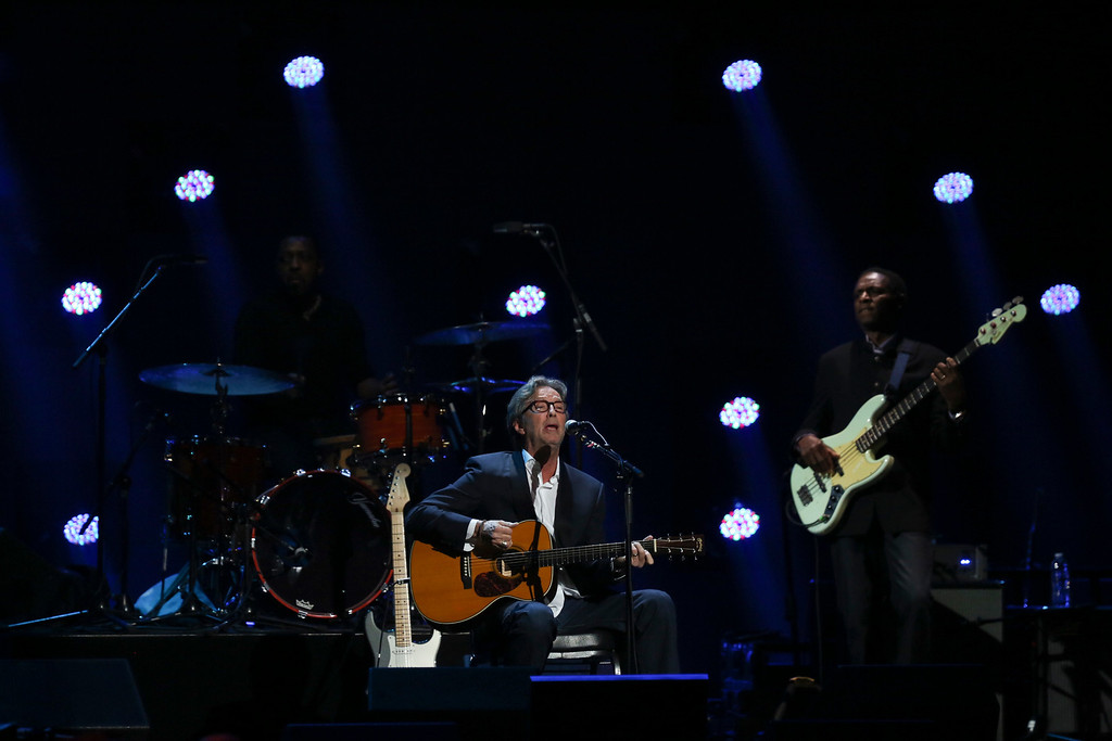 . Eric Clapton plays acoustic guitar during his set at the 12-12-12 benefit concert for victims of Hurricane Sandy, at Madison Square Garden in New York, Dec. 12, 2012. The concert features a lineup of artists spanning five decades. (Damon Winter/The New York Times)