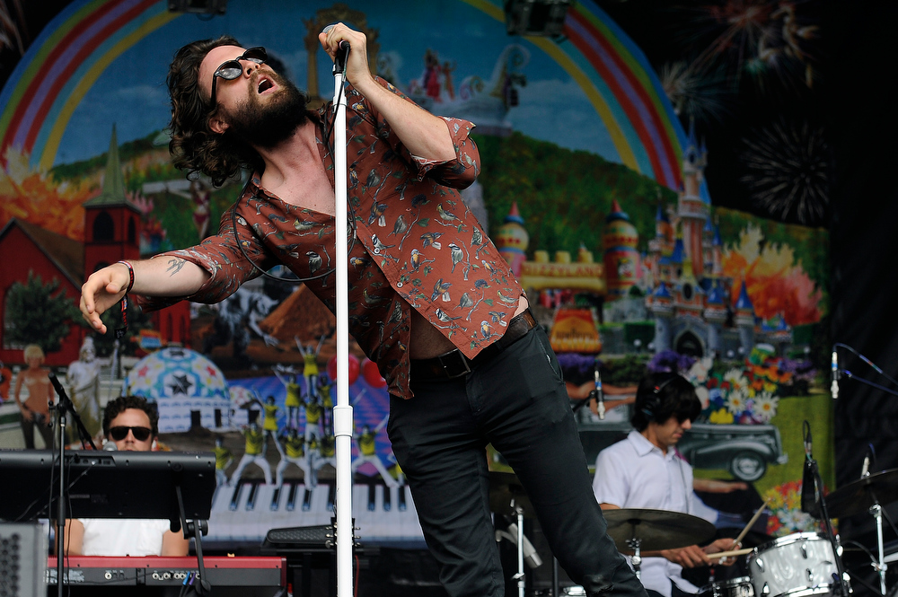 Description of . Joshua Tillman of Father John Misty  performs during Lollapalooza at Grant Park on August 2, 2013 in Chicago, Illinois. (Photo by Seth McConnell/The Denver Post)