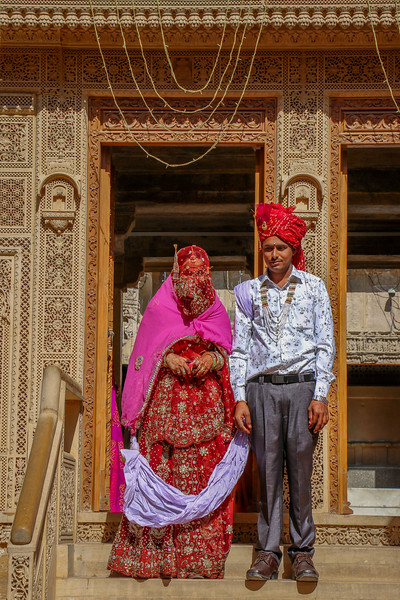 A couple on their wedding day leaving the Hindu temple.