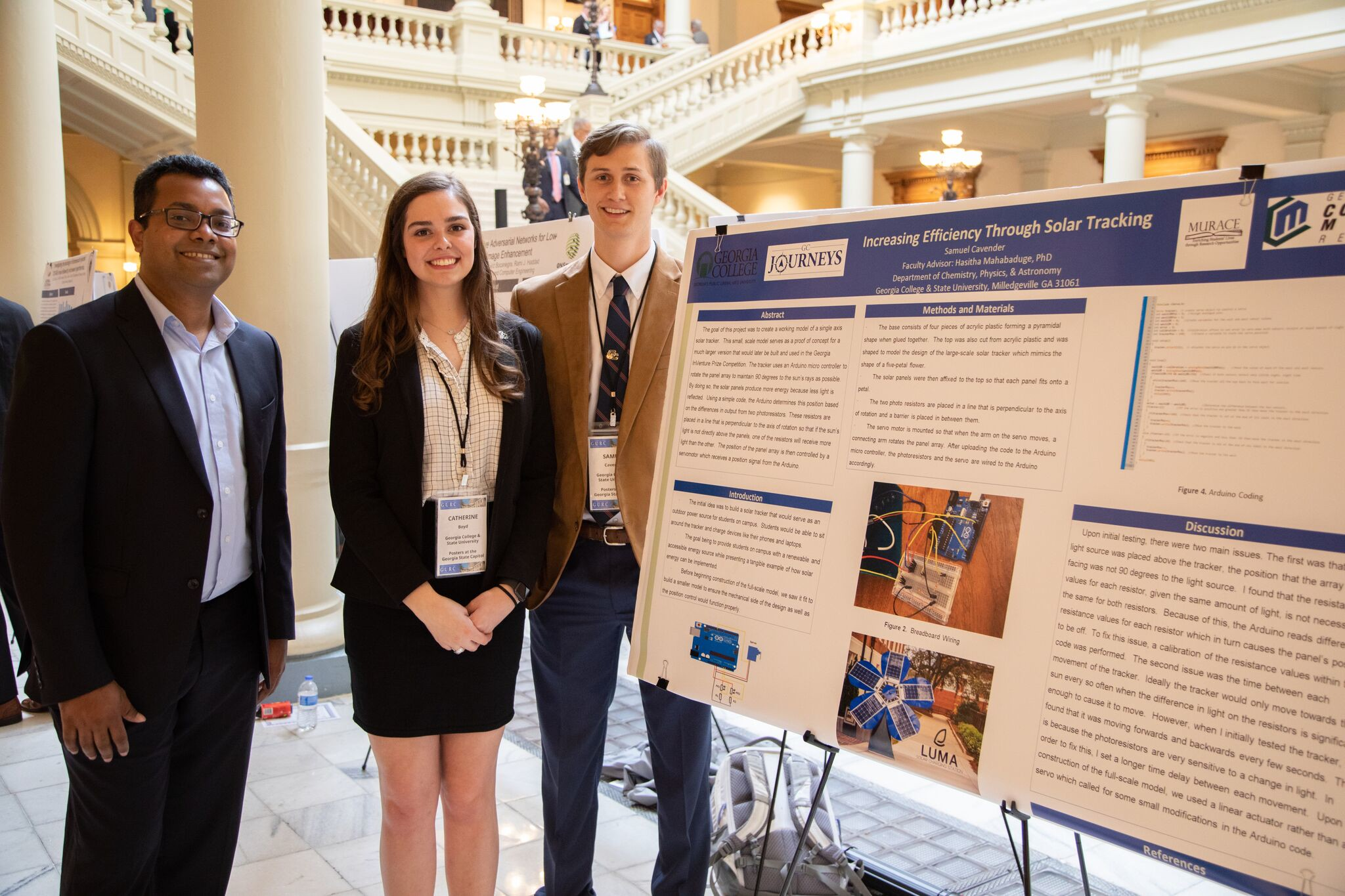 Dr. Hasitha Mahabaduge with junior Catherine Boyd and recent graduate Bo Cavender at Posters at the Capitol this spring.