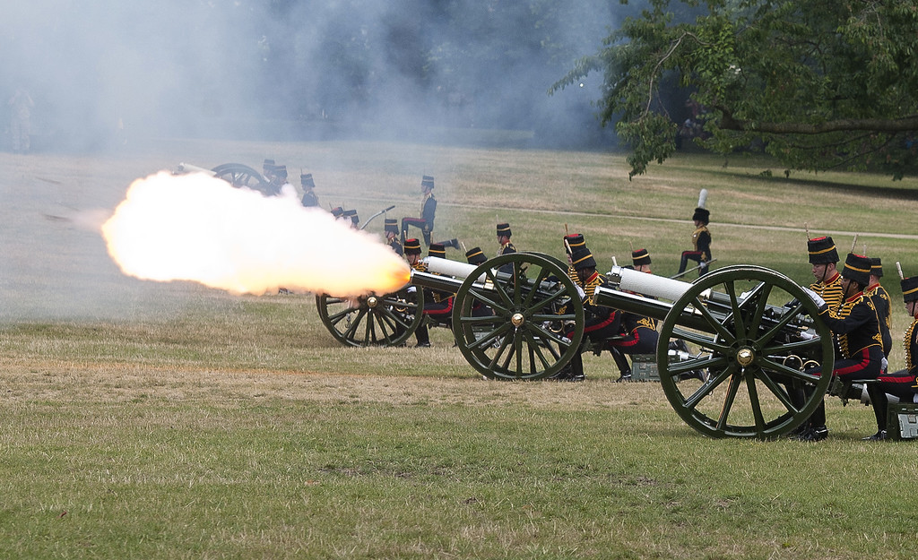 . Members of the Kings Troop Royal Horse Artillery fire a 41 gun salute to mark the birth of the new royal baby, in The Green Park, central London on July 23, 2013. International messages of congratulations poured in for the Duke and Duchess of Cambridge following the birth of the third in line to the throne, celebrated by gunfire salutes across London. AFP PHOTO / WILL OLIVER/AFP/Getty Images