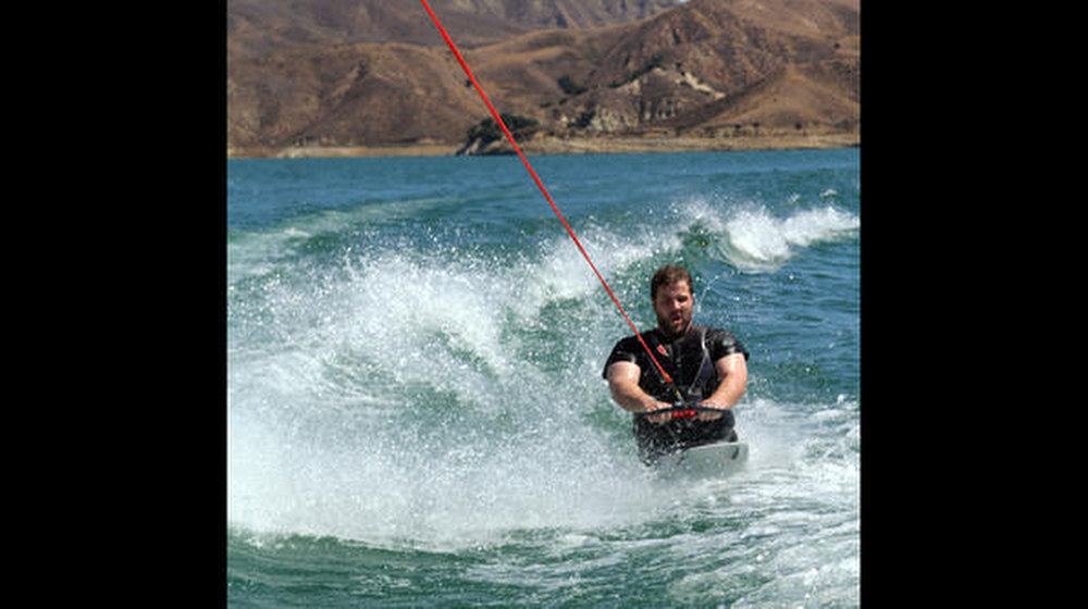 Description of . Kevin teams up with a Hollywood stuntman to build a custom board that makes it possible for him to wakeboard out on Lake Piru in California.
